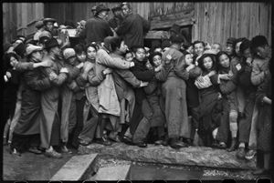 At the end of the day, people wait in line hoping to buy gold. Shanghai, 23 December 1948 by Henri Cartier-Bresson contemporary artwork
