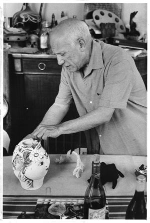 Pablo Picasso travaillant pot-tête en céramique Pour Jacqueline [Pablo Picasso working on ceramic pot-head For Jacqueline] by David Douglas Duncan contemporary artwork