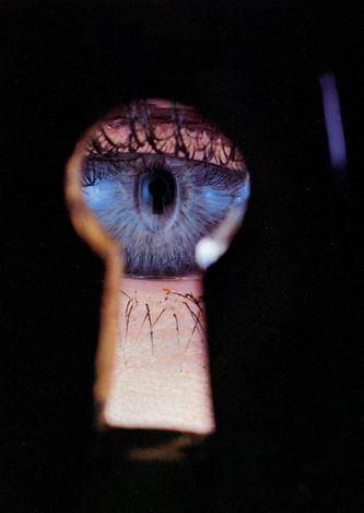 Irving Penn,Eye In Keyhole, New York (1953). Dye transfer print mounted to board. 49.8 × 33.7 cm, image, 52.1 × 35.6 cm, paper, 57.5 × 41.3 cm, mount. © Condé Nast.