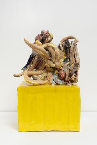 Ghada Amer, Thought #7 Writing on a Yellow Base (2017). Glazed ceramic. 16.5 x 6.6 x 10.4 cm. Courtesy Kewenig.