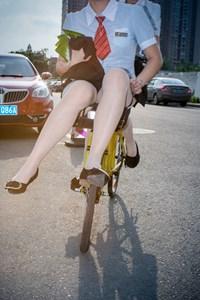 Cycling girl 骑自行车的女孩 by Feng Li contemporary artwork photography