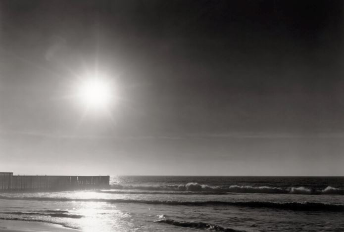 Thomas Joshua Cooper, Looking into the Sun—Late Afternoon The California/Mexico Border Fence—The End The North Pacific Ocean The Sun is the bullet Border Field State Park Tijuana River Valley Beach San Diego County California USA North America (2018) (printed 2019) (detail). © Thomas Johsua Cooper. Courtesy Los Angeles County Museum of Art.