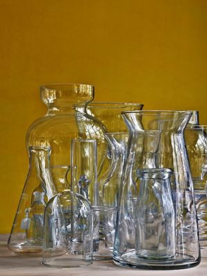 Glassware Vertical Still Life Against Ochre Wall by Abelardo Morell contemporary artwork