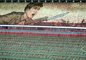 A mass game to celebrate Kim Il-Sung's birthday at the hundred-thousand seat Kim Il-Sung stadium, Pyongyang, North Korea by Hiroji Kubota contemporary artwork