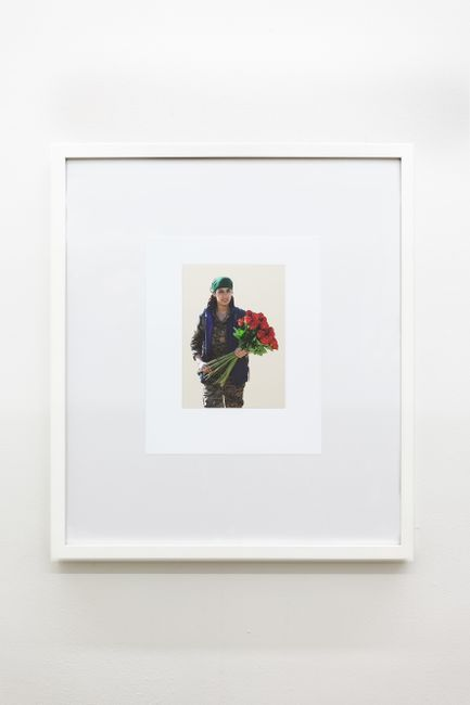 YPJ fighter handing out roses to women rescued from ISIS on International Women's Day 8th March 2017 by Michael Wilkinson contemporary artwork