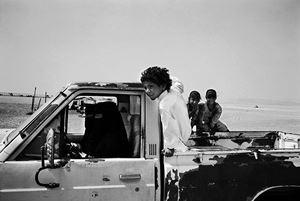 Bedouin women driving a car in the Empty Quarter, Sharoura, Saudi Arabia by Samer Mohdad contemporary artwork